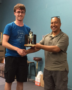James Wratt was awarded the Most Improved Player trophy by Musical Director Dave Fiu